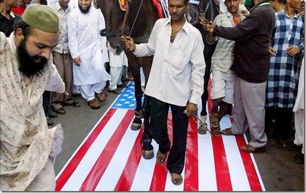 Muslims Walking on U.S. Flag