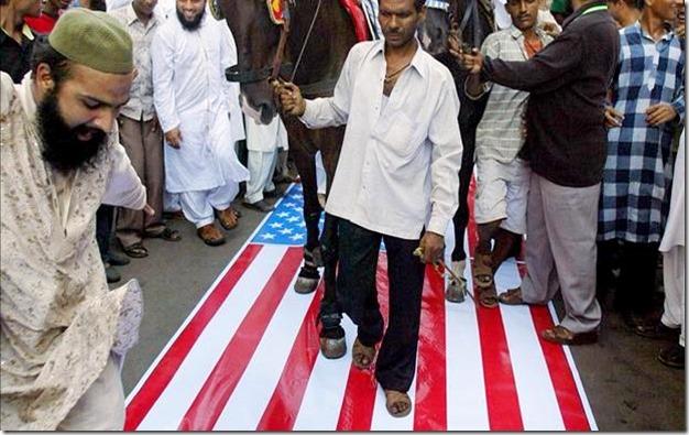 Muslims Walking on U.S. Flag