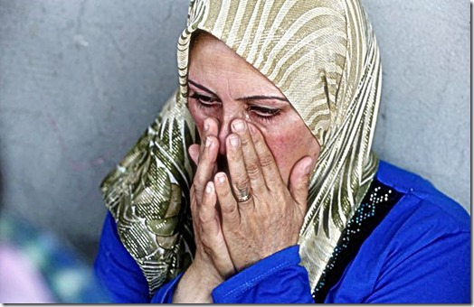 A Syrian woman grieves. (Photo- © Reuters)