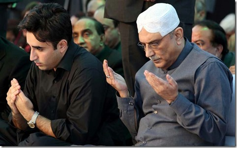GARHI KHUDA BUX, PAKISTAN, DEC 27: Former President and Co-Chairman Peoples Party (PPP), Asif Ali Zardari and Peoples Party (PPP) Patron-in-Chief Bilawal Bhutto Zardari offer Fateha during public gathering on the occasion of Benazir Bhutto Sixth Death Anniversary, held in Garhi Khuda Bux on Friday, December 27, 2013. From all over the Pakistan devotees of Benazir Bhutto and activities of Peoples Party are attending congregation of Benazir Bhutto death anniversary in the form of convoys. (Jamal Dawoodpoto/PPI Images).