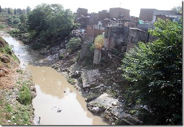 Katchi Abadi slum near unsanitary creek