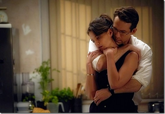 Katie Holmes and Ryan Reynolds as Pam and Randol Schoenberg