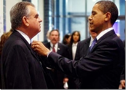Obama fixes the tie of his Transportation Secretary, Ray LaHood