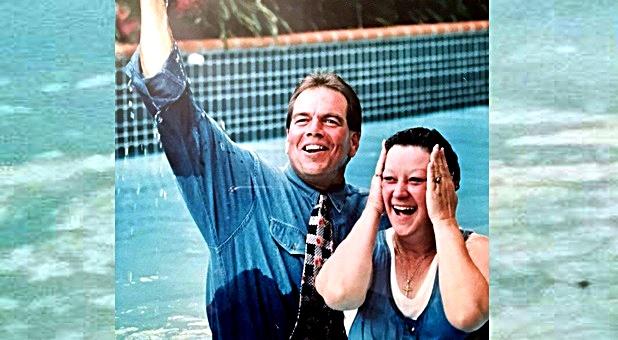 rev-benham-baptizing-norma-mccorvey-1995